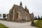 Full side  view of Aulnay de Saintonge church — Stock Photo