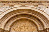 Fine romanesque  archivolts and tympanum in San isidoro Leon — Stock Photo