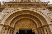 Wide view of  romanesque  archivolts and tympanum in San isidoro — Stock Photo
