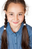 A young girl with long pigtails — Stock Photo
