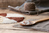 White and red rice in a wooden spoon — Stock Photo