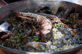 Paella negra in the pan — Stock Photo