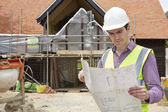 Architect On Building Site Looking At House Plans — Stock Photo
