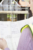 Architect On Building Site Looking At Plans For House — Stock Photo