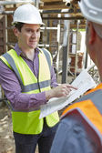 Architect Discussing Plans With Builder — Stock Photo