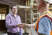 Customer Shaking Hands With Builder — Stock Photo