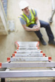 Construction Worker Falling Off Ladder And Injuring Leg — Stock Photo