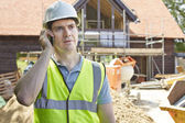 Construction Worker On Building Site Using Mobile Phone — Stock Photo