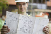 Construction Worker On Building Site Looking At House Plans — Stock Photo
