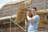Thatcher Carrying Bundles Of Reeds Working On Roof — Stock Photo