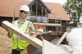 Builder Putting Waste Into Rubbish Skip — Stock Photo