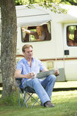 Man Relaxing Outside Mobile Home On Vacation — Stock Photo