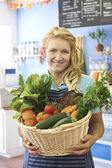 Woman Working In Shop With Basket Of Fresh Produce — Photo