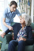 Care Worker Mistreating Senior Woman — Stock Photo