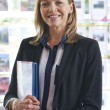 Portrait Of Female Estate Agent In Office — Stock Photo #49705837