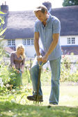 Couple Working In Garden At Home Together — Foto de Stock