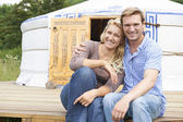 Couple Enjoying Camping Holiday In Traditional Yurt — Stock Photo