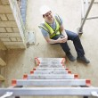 Construction Worker Falling Off Ladder And Injuring Leg — Stock Photo #49756319