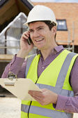 Architect On Building Site Using Mobile Phone — Stock Photo