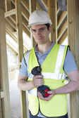 Builder On Construction Site Holding Cordless Drill — Zdjęcie stockowe