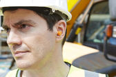 Construction Worker Wearing Protective Ear Plugs — Stock Photo