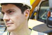 Строительный рабочий, носить защитные Вкладыши противошумные — Стоковое фото