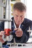 Engineer Working On Machine In Factory — Stock Photo