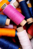 Background with multi color thread spools — Stock Photo