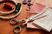 Close-up sewing tools on wooden background, vintage style — Stock Photo