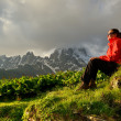 Young woman in red jacket enjoy sunset in mountains — Stock Photo #49258851