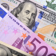 Dollar and euro bank notes on the table — Zdjęcie stockowe
