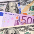 Dollar and euro bank notes on the table — Stockfoto