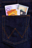Dollar, euro bank notes and credit cards in jeans pocket — Stock Photo