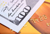 Close-up dollar note on credit card with shallow depth of field — Stock Photo