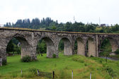 Beautiful ancient stone arch bridge — Stock Photo