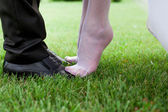 Bride's and groom's shoes — Stock Photo