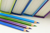 Books and crayons in cool colors. — Stock Photo