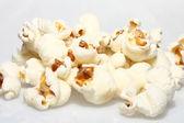 Popcorn upclose on plain white background — Foto de Stock