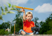 Little boy playing with airplane — Stock Photo