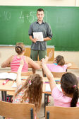 Elementary School Students at Classroom Desks — ストック写真