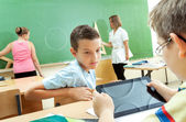 Elementary School Students at Classroom Desks — Stock Photo