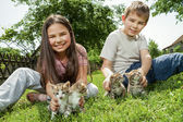 Happy children with a little cat — Stock Photo