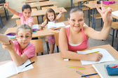 Elementary School Students at Classroom Desks — Стоковое фото