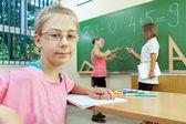 Elementary School Students at Classroom Desks — Foto Stock