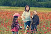 Vintage family on the poppy meadow — Stock Photo