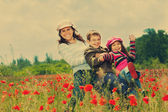 Vintage family on the poppy meadow — Stock Photo