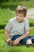 Happy little boy with a little cat — Stock Photo
