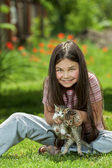Happy little girl  with a little cat — Stock Photo