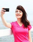Young Woman Showing display phone — Stock Photo