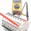 Electric switch on the control panel and multimeter — Stock Photo #48755805